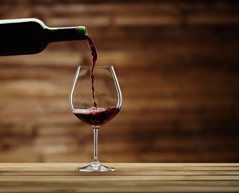 bigstock-Pouring-red-wine-into-the-glas-64905025-1200x970